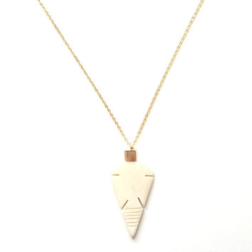 Arrowhead Bone Pendant on a Long Gold Chain