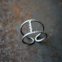 thumb twist ring. sterling silver ring. soft black ring. hammered ring. rope silver ring