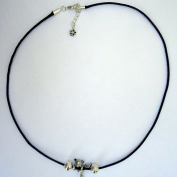 Leather rope necklace in black with silver tone bear and silver plated beads on either side. 18 inches  and extension