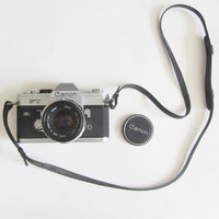 1966 Canon FT QL camera . black silver 35mm SLR . 50mm lens plus flash