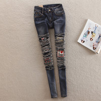 Fashion Personality Pattern Patch Irregular Ripped Worn Beggar Long Jeans Small Foot Pants