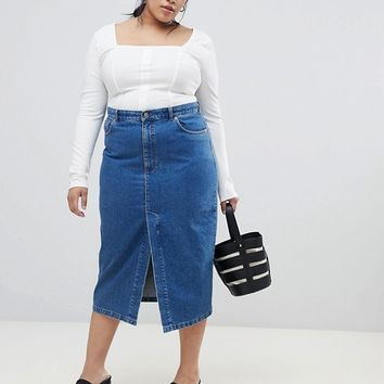 316455795f ASOS DESIGN Curve denim midi skirt with split front in midwash blue at asos .com