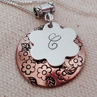 Personalized monogram initial necklace with floral stamped domed copper background disc. Sterling silver and copper. Celebrity Jewelry.