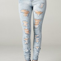 Heavy Distressed High Rise Light Wash Skinny Denim