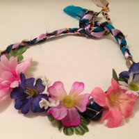 lovely flower crown with stone and feather