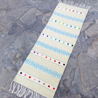 White handwoven boho rug with blue pattern and colorful felt motifs - unique white rug for your home decor