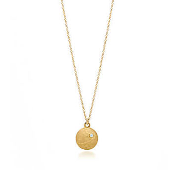 Tiffany & Co. - Paloma Picasso® Hammered Circles pendant in 18k gold with a diamond, small.