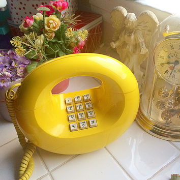 Vintage 70's donut phone sculptura push button purse phone yellow western electric mid century