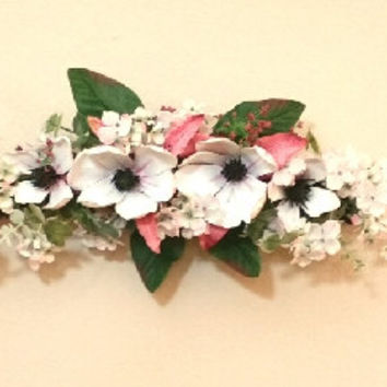 Swag floral arrangement : Magnolias and hydrandeas on twig base #floralarrangements