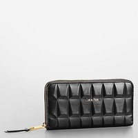 kedra geometric embossed leather zip continental wallet | Calvin Klein