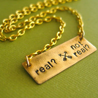 Hunger Games Necklace Real or Not Real in Brass by SpiffingJewelry