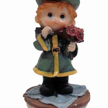 Boy Fireman Holding Ax And Bouquet Of Flowers