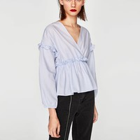 RUFFLED TOP WITH CROSSOVER NECKLINE