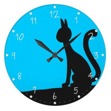 Cat calmly watching in silence large clock