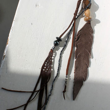Brown leather feather art bag charm key charm bag tassel primitive tribal leather amulet for purse