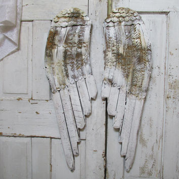 White angel wings wall decor French Nordic wood and metal painted distressed rusty Santos hanging wall hanging anita spero