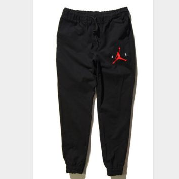 Four Seasons AJ Flyer STUSSY embroidery icon cotton cloth trousers tide men sports and leisure pants nine ankle banded pants