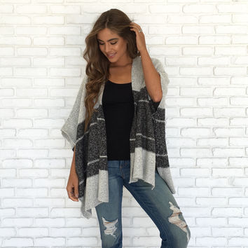 Holding Back Poncho Sweater