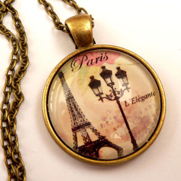 Enchanting necklace with Eiffel tower design and lantern, Paris Necklace, France jewelry, round necklace, bronze necklace