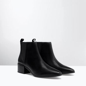 Block heel elastic leather bootie