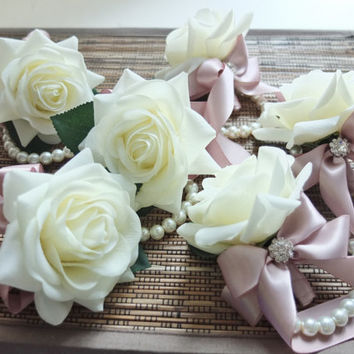 Wrist Corsage, Off White Rose with Duty Pink ribbon on pearl bracelet