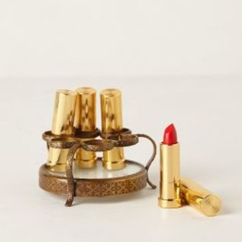 Round Vestige Lipstick Holder by Anthropologie in Bronze Size: One Size Vests