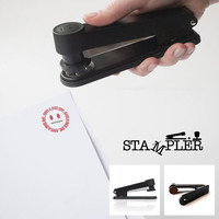 Stampler : Works like a normal stapler, prints a smiley face at the same time