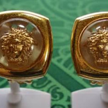 Vintage Gianni Versace clear and gold tone medusa sunburst motif clip earrings. Gaga and chic style. Great gift