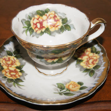 Vintage 1950s NAPCO Porcelain Hand Painted Tea Cup And Saucer Yellow Flower Motif With Paper Label