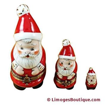 NEST SANTA W/BALL ON CAP LIMOGES BOX