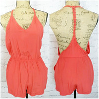 TOES IN THE SAND ROMPER IN CORAL