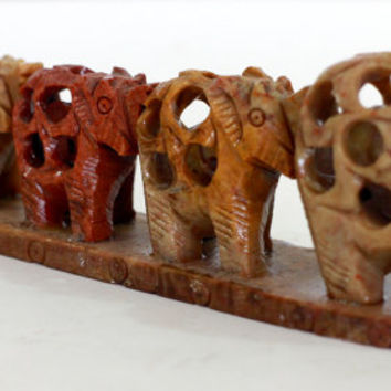Elephants in line with baby inside  Figurine - resin from old Sri Lanka technology.