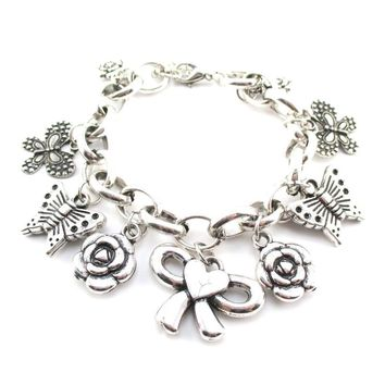 Flowers Butterflies and Bows Charm Bracelet in Silver | DOTOLY