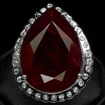 A Rare 44.8CT Pear Cut Blood Red Ruby Halo Ring