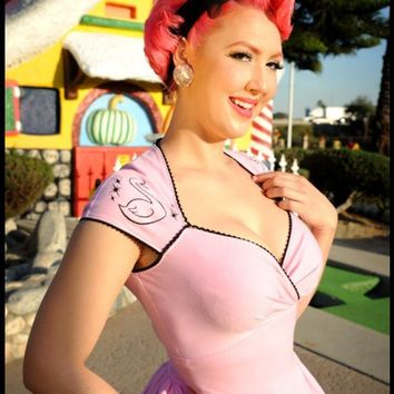 Pinup Couture - Luscious Dress in Pink with Black Swan and Atomic Starbursts | Pinup Girl Clothing