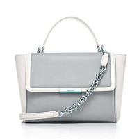 Tiffany & Co. -  Quinn top handle bag in smooth and grain leather, large. More colors available.