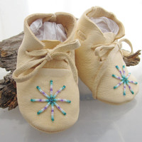 Authentic Native American made baby moccasins of soft deer hide and glass seed beads in a southwest starburst design
