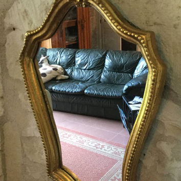 French Vintage Gilded Mirror with Scroll Capital in a Sheild Form.