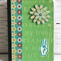 Green Girl Scout Mini Journal with Flower and Three-Finger Salute, Altered Composition Book