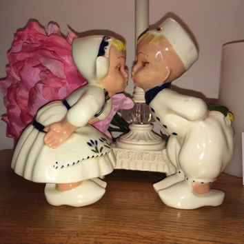 Vintage Dutch Boy and Girl Kissing Figurines in Wooden Traditional Shoes Perfect for Valentines Day in Blue White Holding Flowers for Smooch