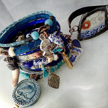 Rustic tribal bangle set in blue with soldered china, Milagros, Buddha amulet