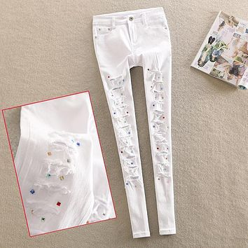 2017 spring new diamond jeans female personality white Rhinestone pants hole pencil jeans plus size
