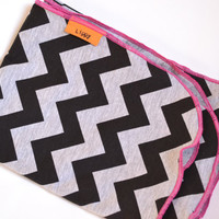 Modern baby swaddler. Chevron printed fabric. Blanket size: Size 31 by 40 inches. Colors- Black and gray with pink edging.