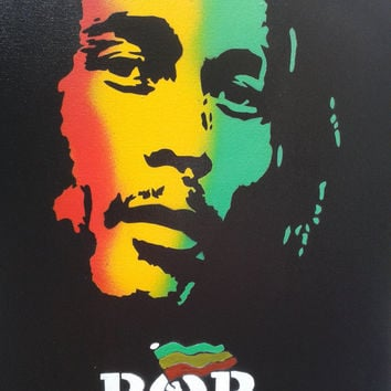 Bob Marley painting on canvas,stencils & spray paints,urban,rggae,music,dreadlock,jamaica,rastafarian,artist,red,yellow,green,black,graffiti