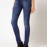 ASOS Supersoft High Waisted Ultra Skinny Jeans in Mid Stonewash at asos.com