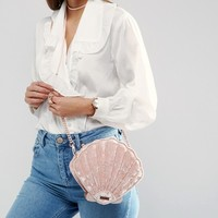 Skinnydip Exclusive Crushed Velvet Shell Cross Body Bag in Blush at asos.com