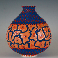 Vase with vibrant matte blue base glaze with deep red dots and orange shapes,