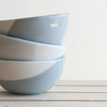 Set of three little bowls in concrete gray and white with glossy glaze.modern and urban look.