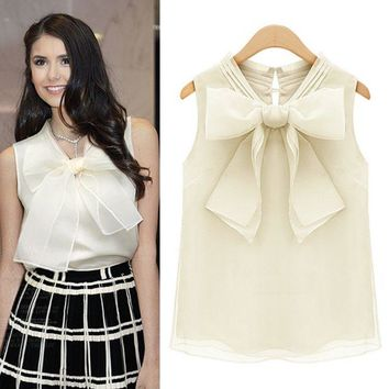 DCCKH3F Big bow sleeveless blouse
