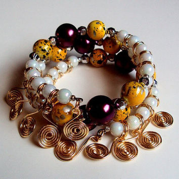 Yellow burgundy and white beaded bauble memory wire spiral multi strand wrap bracelet with silver-plated gold finish coiled wire charms